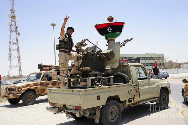 Ajadabiya Print featuring the photograph A Free Libyan Army Pickup Truck by Andrew Chittock