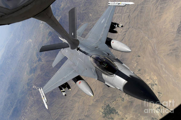 Afghanistan Print featuring the photograph An F-16 Fighting Falcon Receives Fuel by Stocktrek Images