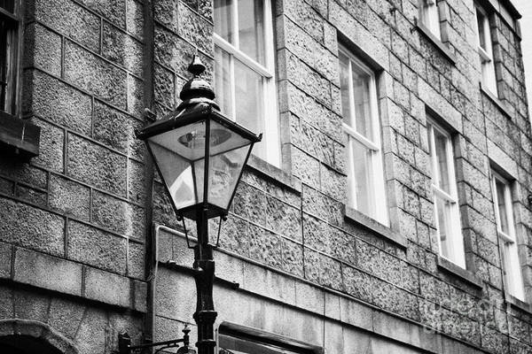 Old Print featuring the photograph Old Sugg Gas Street Lights Converted To Run On Electric Lighting Aberdeen Scotland Uk by Joe Fox