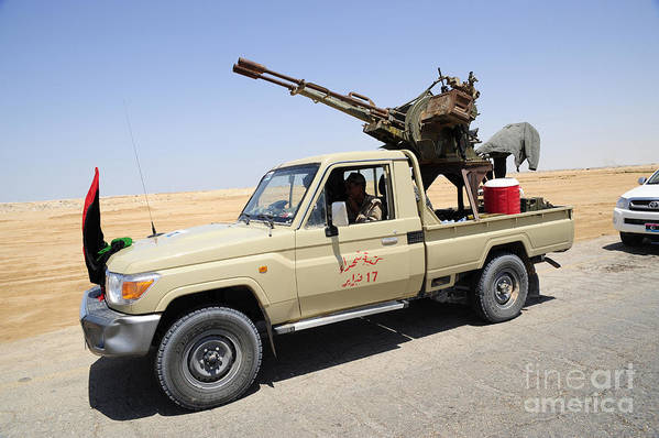 Libya Print featuring the photograph A Free Libyan Army Pickup Truck by Andrew Chittock