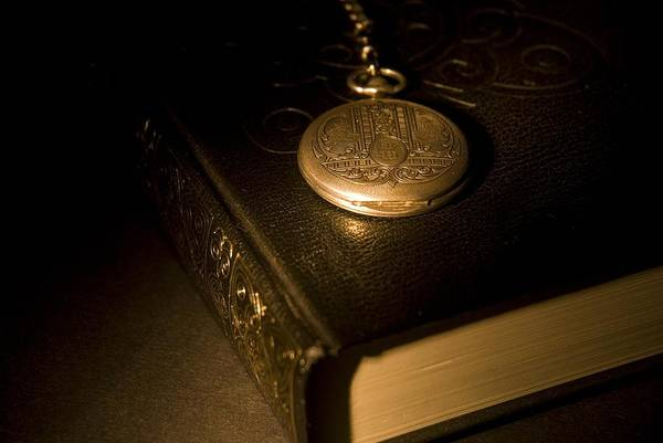 Antique Print featuring the photograph Gold Pocket Watch Resting On A Book by Philippe Widling