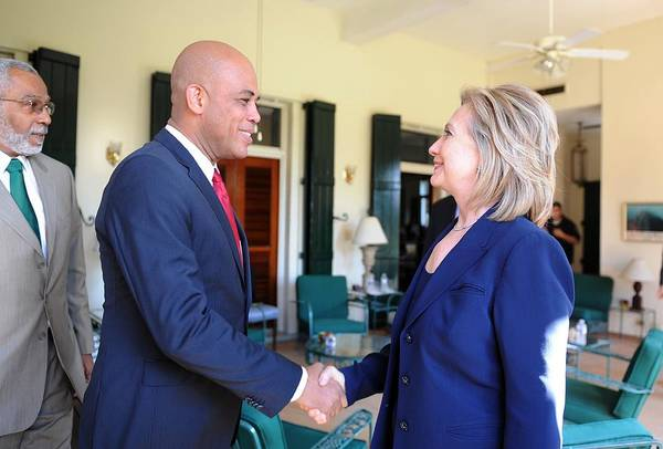 History Print featuring the photograph Hillary Clinton Meets With Haitian by Everett