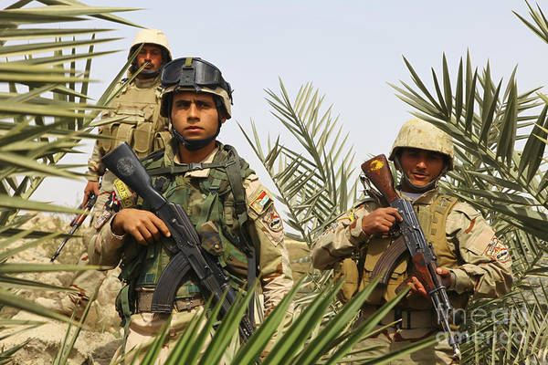Iraq Print featuring the photograph Iraqi Soldiers Conduct A Foot Patrol by Stocktrek Images