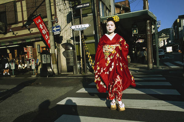 Entertainers Print featuring the photograph Kimono-clad Geisha Crosses A Street by Justin Guariglia
