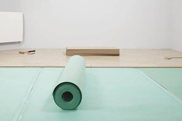 Nobody Print featuring the photograph Laying A Floor. A Roll Of Underlay Or by Magomed Magomedagaev