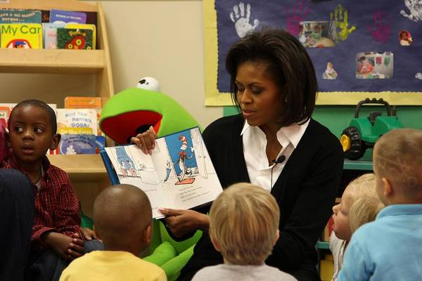 History Print featuring the photograph Michelle Obama Reads The Cat In The Hat by Everett