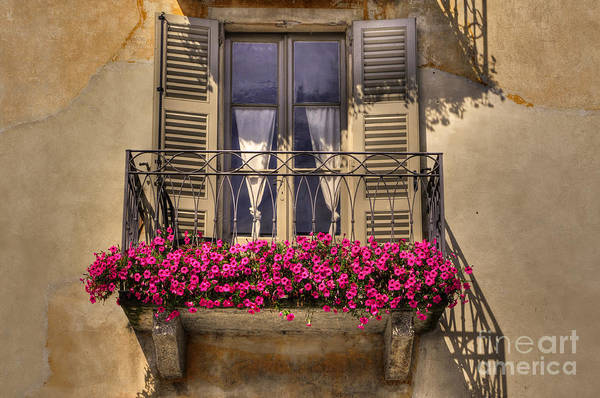 Balcony Print featuring the photograph Old Balcony With Red Flowers by Mats Silvan