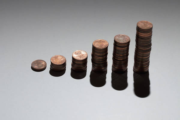 Horizontal Print featuring the photograph Rows Of Stacks Of Five Cent Euro Coins Increasing In Size by Larry Washburn