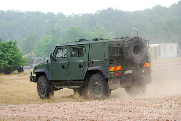 Military Print featuring the photograph The Iveco Light Multirole Vehicle by Luc De Jaeger