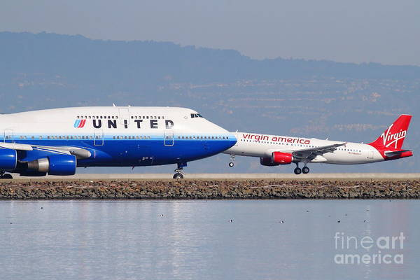 Virgin Print featuring the photograph United Airlines And Virgin America Airlines Jet Airplanes At San Francisco International Airport Sfo by Wingsdomain Art and Photography
