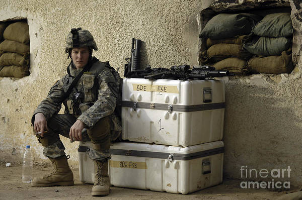 Operation Iraqi Freedom Print featuring the photograph U.s. Army Soldier Relaxing Before Going by Stocktrek Images