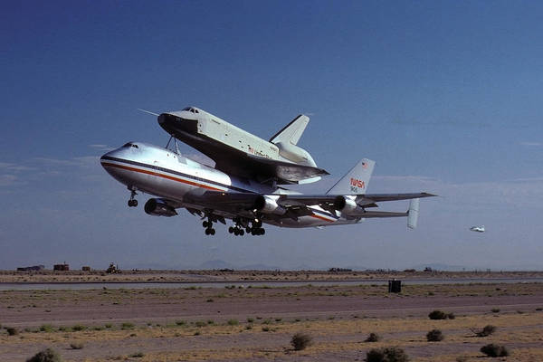 Space Print featuring the photograph 747 Takes Off With Space Shuttle Enterprise For Alt-1 by Brian Lockett