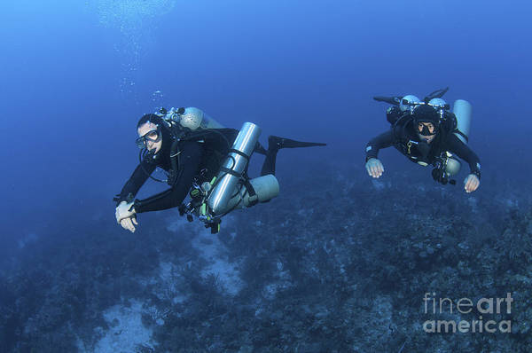 Caribbean Sea Print featuring the photograph Technical Divers With Equipment by Karen Doody