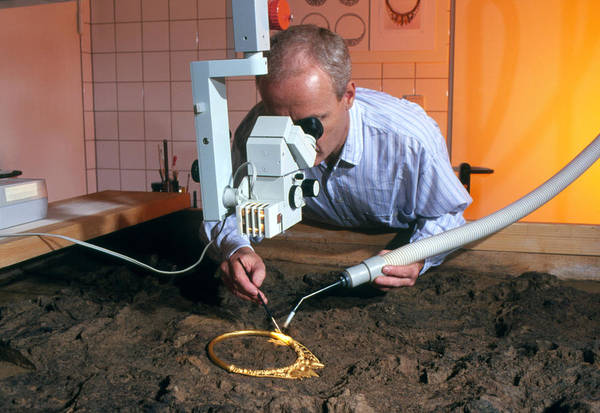 Celtic Necklace Print featuring the photograph Archaeologist Cleaning A Golden Celtic Necklace by Volker Steger