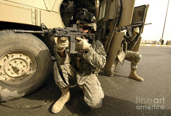 Operation Iraqi Freedom Print featuring the photograph U.s. Army Soldiers Providing Overwatch by Stocktrek Images