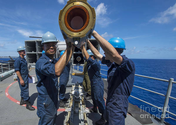 Uss Boxer Print featuring the photograph Sailors Load Rim-7 Sea Sparrow Missiles by Stocktrek Images