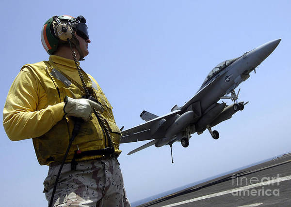 Horizontal Print featuring the photograph An Officer Observes An Fa-18f Super by Stocktrek Images