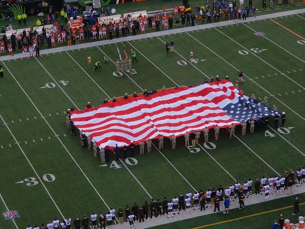 American Flag At Paul Brown Stadium Print featuring the photograph National Anthem by Dan Sproul