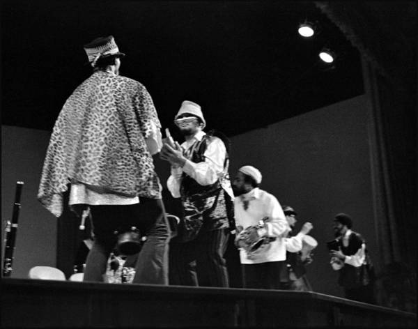 Sun Ra Arkestra At Freeborn Hall Print featuring the photograph Arkestra Procession 1968 by Lee Santa
