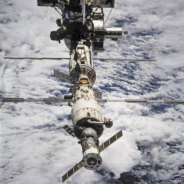 No People; Square Image; Outdoors; Day; Elevated View; Mid-air; Flying; Science; Technology; Travel; Space Station; Space Mission; Earth; Space; Space Exploration; 2009; Planet; Cloud Print featuring the photograph International Space Station by Anonymous
