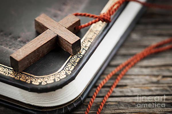 Cross Print featuring the photograph Cross On Bible by Elena Elisseeva