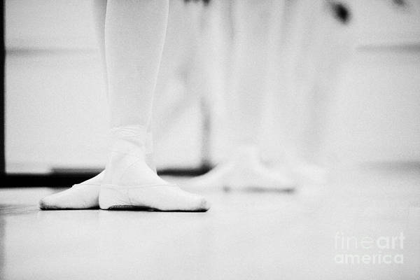 Ballet Print featuring the photograph Students With Feet In The Third Position At A Ballet School In The Uk by Joe Fox