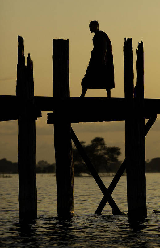 Buddhist Print featuring the photograph Buddhist Monk Walking Over U Bein's Bridge At Sunset by Ruben Vicente