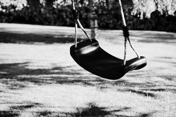 Empty Print featuring the photograph Empty Plastic Swing Swinging In A Garden In The Evening by Joe Fox