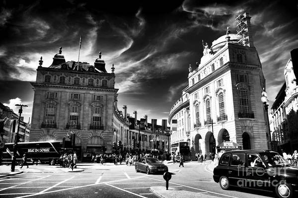 Piccadilly Circus Print featuring the photograph Piccadilly Circus by John Rizzuto