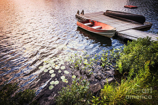 Boat Print featuring the photograph Rowboat At Lake Shore At Sunrise by Elena Elisseeva