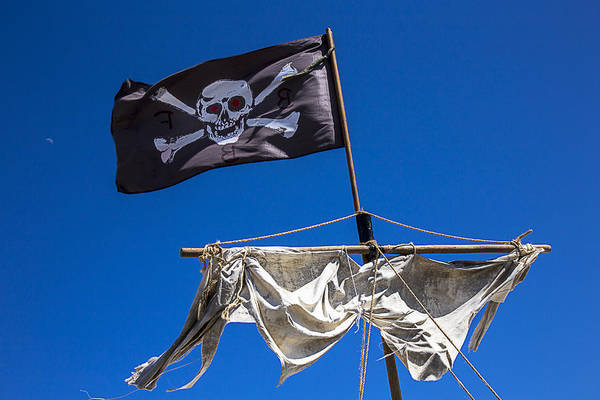 Pirate Flag Skull Banner Piracy Scull Robbers Terror Terrorist F Print featuring the photograph The Death Flag by Garry Gay