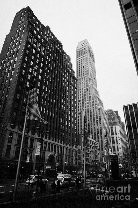 Usa Print featuring the photograph view of pennsylvania bldg nelson tower and US flags flying on 34th street from 1 penn plaza by Joe Fox