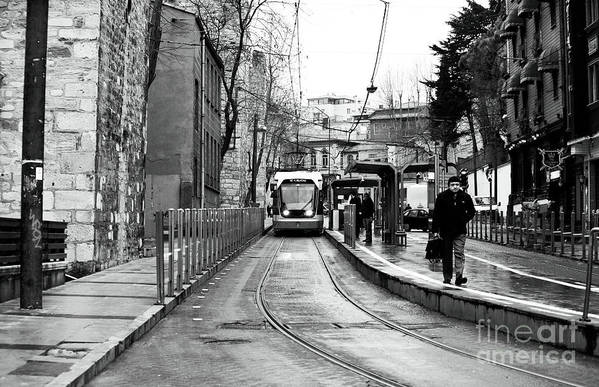 Waiting For The Tram In Istanbul Print featuring the photograph Waiting For The Tram In Istanbul by John Rizzuto