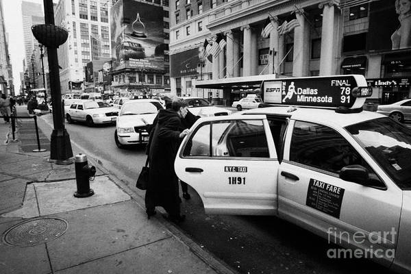 Usa Print featuring the photograph white middle aged passengers exit from yellow cab rear door at taxi rank on 7th Avenue by Joe Fox