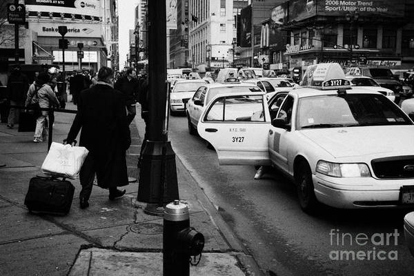 Usa Print featuring the photograph Yellow Cab On Taxi Rank Outside Madison Square Garden On 7th Avenue New York City Usa by Joe Fox