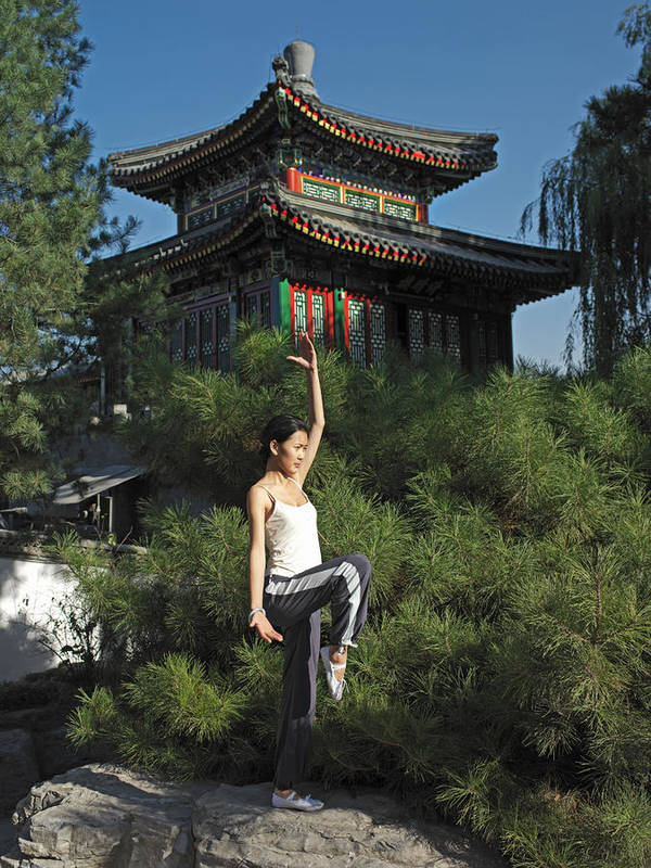 One Person Print featuring the photograph A Chinese Woman In Her 20s To 30s Doing by Justin Guariglia