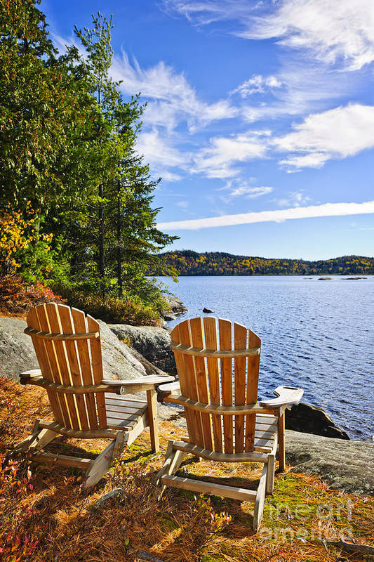 Chairs Print featuring the photograph Adirondack Chairs At Lake Shore by Elena Elisseeva