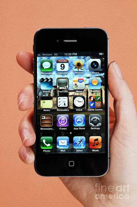 App Print featuring the photograph Hand Holding An Iphone by Photo Researchers
