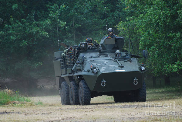 Military Print featuring the photograph The Pandur Recce Vehicle In Use by Luc De Jaeger