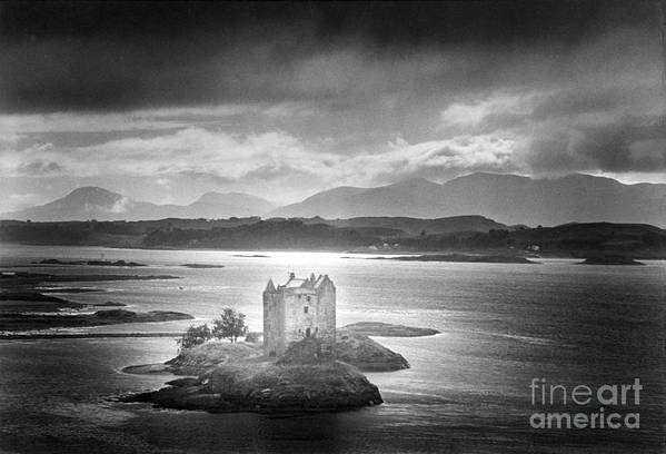Medieval; Scottish; Landscape; Lake; Ominous; Foreboding; Brooding; Stormy Weather; Clouds; Dark; Mountains; Mountainous; Island; Exterior; Architecture; Gothic; Striking; Dramatic; Eerie; Mysterious; Mystery; Haunting; Haunted; Sinister; Spooky; Ghostly; Ethereal Print featuring the photograph Castle Stalker by Simon Marsden
