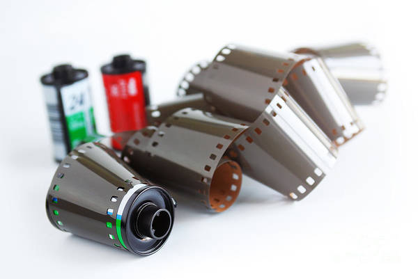 35mm Print featuring the photograph Film And Canisters by Carlos Caetano