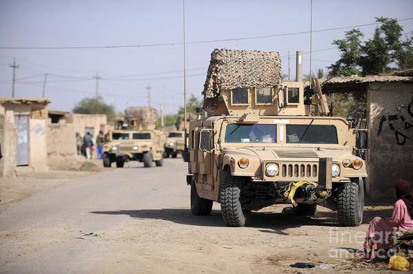 Sitting Print featuring the photograph Humvees Conduct Security by Stocktrek Images