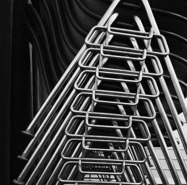 Abstract Print featuring the photograph Stacks Of Chairs by Anna Villarreal Garbis