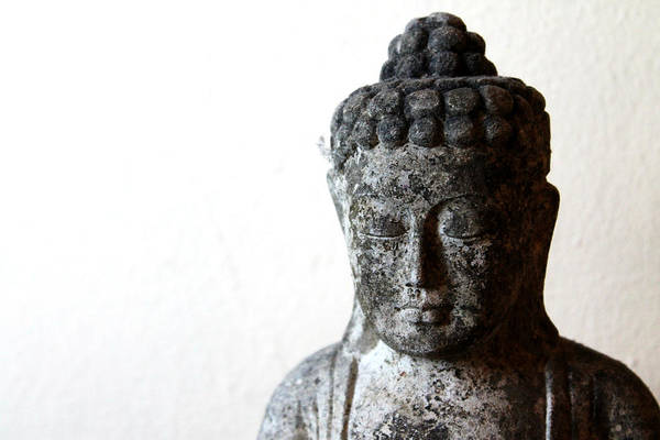 Buddha Print featuring the sculpture Stone Buddha by Janita Topan