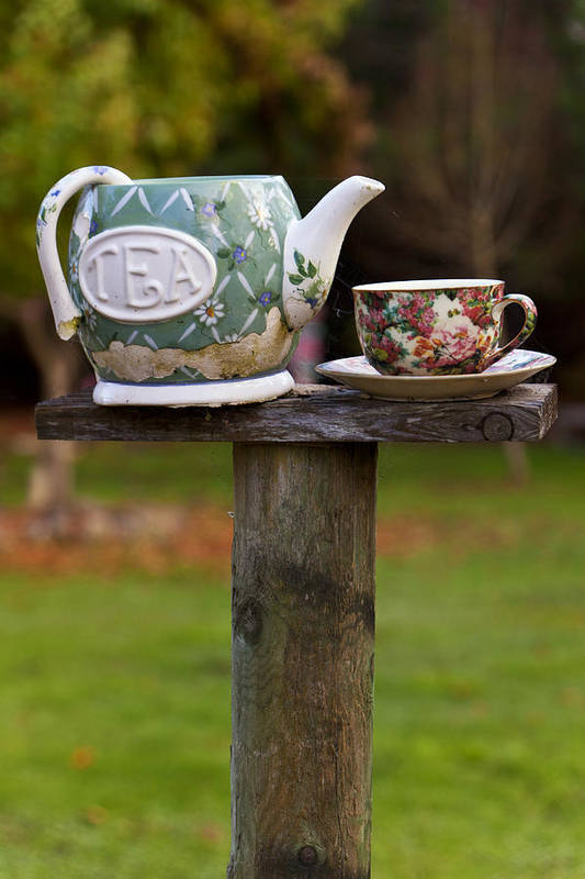 Teapot Print featuring the photograph Teapot And Tea Cup On Old Post by Garry Gay