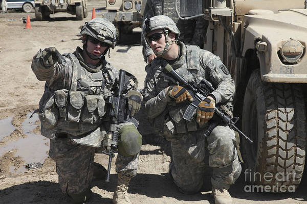 Military Print featuring the photograph U.s. Soldiers Coordinate Security by Stocktrek Images