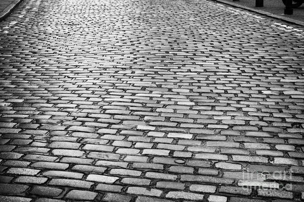 Wet Print featuring the photograph Wet Cobblestoned Huntly Street In The Union Street Area Of Aberdeen Scotland by Joe Fox