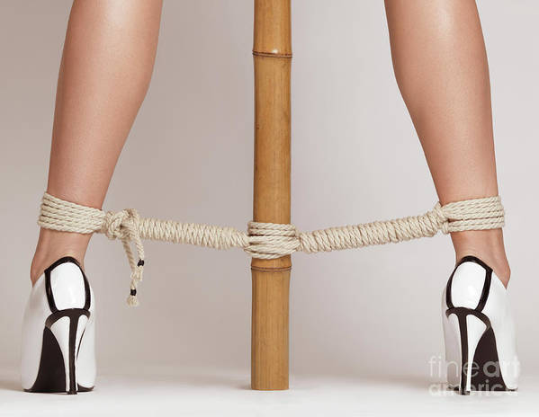 Bondage Print featuring the photograph Woman Legs Tied With Ropes To Bamboo by Oleksiy Maksymenko