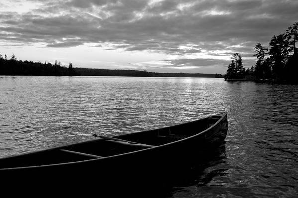 Absence Print featuring the photograph Abandoned Canoe Floating On Water by Keith Levit