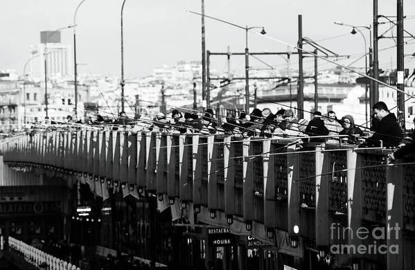 Fishing On The Galata Bridge Print featuring the photograph Fishing On The Galata Bridge by John Rizzuto